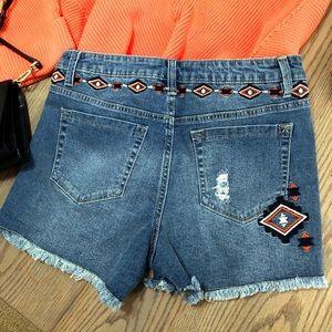 Nanette Lepore mid rise cutoff denim shorts